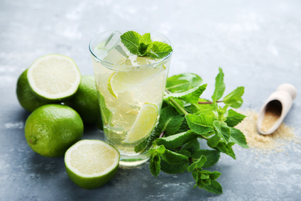 Mojito cocktail in glass on grey wooden table
